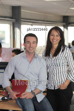 Nice Man And Woman Working In An Office Stock Photo