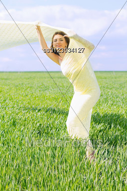 Nice Young Woman Wrapped In Yellow Cloth Stock Photo