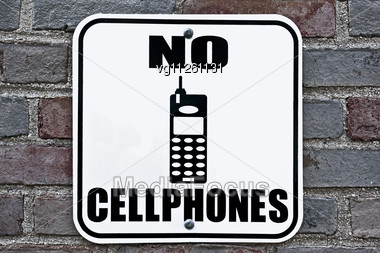 No Cellphones Metal Sign On A Brick Wall Stock Photo