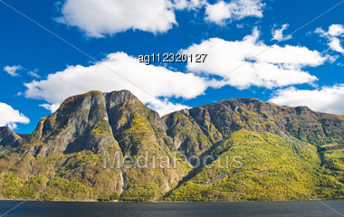 Norwegian Landscapes. Fiords, Mountains And Blue Sky Stock Photo