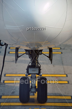 Nose Wheel On Commercial Airliner Stock Photo