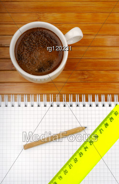 Notebook Pencil Line And Coffee On A Wooden Background Stock Photo