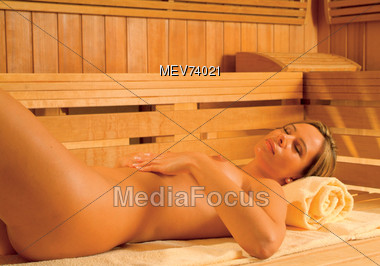 Nude Woman Lying In Sauna Stock Photo