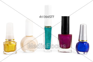 Number Of Different Bottles With Colored Nail Polish Is Isolated Stock Photo