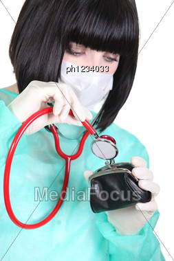 Nurse With Surgical Mask With Stethoscope On Purse Stock Photo