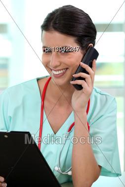 Nurse Talking On The Phone Stock Photo