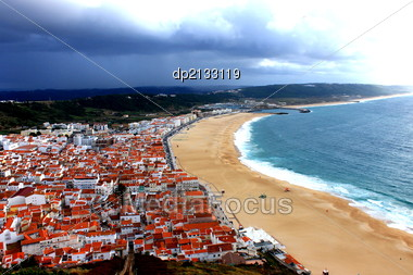 Ocean beach by the town Nazare in Portugal Stock Photo