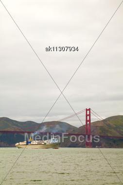 Ocean Vessel Under Golden Gates Bridge In San Francisco In The Morning Stock Photo