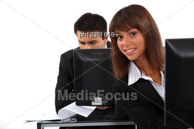 Office Workers Sitting At Desktop Computers Stock Photo