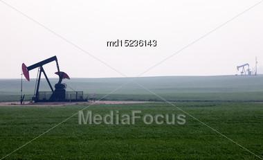 Oil And Gas Pump Jack Prairie Landscape Saskatchewan Canada Stock Photo