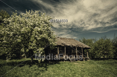 Old Abandoned Hut Under Dramatic Skies, Natural Landscape Stock Photo