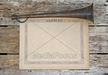 Old art deco blank scrap paper on vintage wood with old horn for sign making Stock Photo
