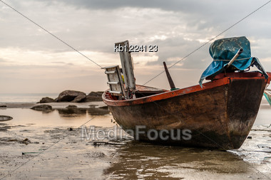 Old Boat On Beach In Overcast Sky Day Evenning Time Stock Photo