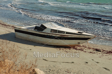 Old Boat On The Beach. Stock Photo