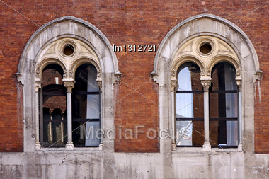 Old Castle Brick Brown And Window Reflex In Piazza Dei Mercanti Milan Stock Photo