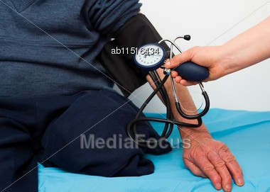 Old Disabled Man Being Investigated By Cardiologist, Measuring Blood-pressure Stock Photo