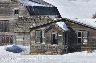 Old Granary And Barn In Winter Saskatchewan Canada Stock Photo