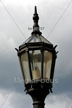 Old Grey Street Lamp And Clouds In Buenos Aires Argentina Stock Photo