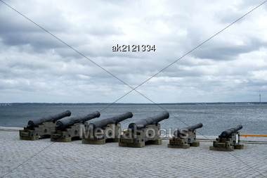 Old Guns Are On Coast On A Background Of The Sea Stock Photo
