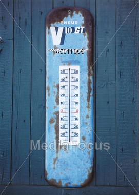 Old Hanging Thermometer Stock Photo