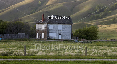 Old House In The Hills In Saskatchewan Canada Stock Photo