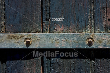 Old Iron Metal Lock Screw And Wood In The Centre Of Colonia Del Sacramento Uruguay Stock Photo