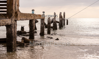 Old Jetty In Sea In Overcast Sky Day Evenning Time Stock Photo