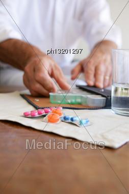 Old Lady Using Pillbox To Keep Medicine Organized Stock Photo