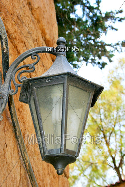 Old Lamp On Vintage Wall Stock Photo