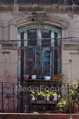 Old Little Terrace Blue Green Venetian Blind And Flower In The Centre Of Buenos Aires La Boca Argentina Stock Photo