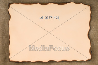 Old Paper With Burn Edges On Canvas Background Stock Photo
