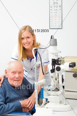 Old Patient Needing Help At The Optometrist's Stock Photo