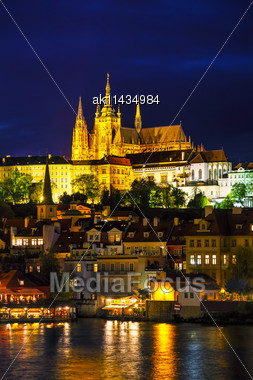 Old Prague Cityscape With The Charles Bridge After Sunset Stock Photo