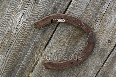 Old Rusty Horse Shoe Mounted On A Wall Stock Photo