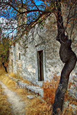 Old Stone House In Dry Grass At Sunny Sunner Day Stock Photo