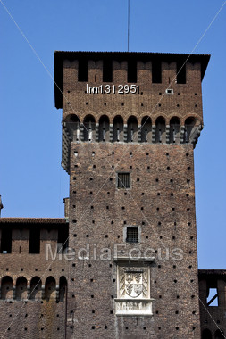 Old Tower Castle Brick Brown And Window In The Grass Of Castle Sforzesco Milan Stock Photo