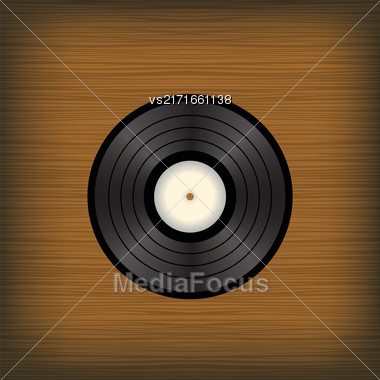 Old Vinyl Disc On Brown Wooden Background Stock Photo