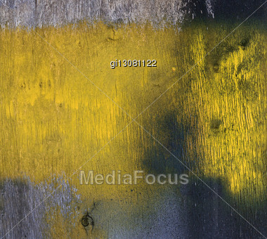 Old Wall Of Plywood Is Stained With Yellow Paint Stock Photo