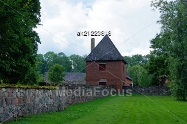 Old Watch Tower And Wall Of Manor Stock Photo