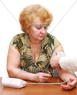 Old Woman Measures Arterial Pressure , With Doctor Helps. Isolated Stock Photo