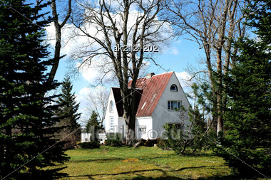 Old Wooden House Is Near To Trees Stock Photo