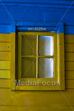 Old Yellow Window In Blue Wall In The Centre Of La Boca Buenos Aires Argentina Stock Photo