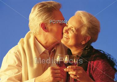 Older Couple Celebrating Stock Photo