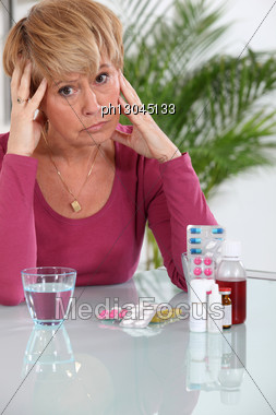 Older Woman Concerned About Her Pills Stock Photo