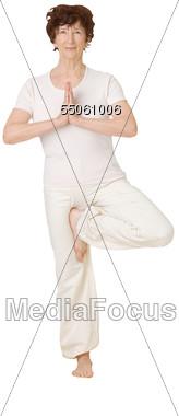 Older Woman Doing Yoga Pose Stock Photo