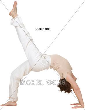 Older Woman Doing Yoga Stretch Stock Photo