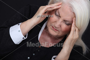 Older Woman With A Headache Stock Photo