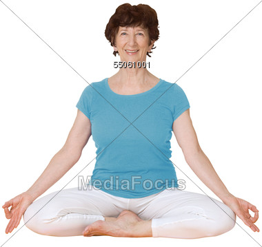 Older Woman In Yoga Seated Position Stock Photo