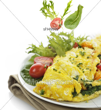 Omelet With Lettuce And Vegetables ,Close Up Stock Photo