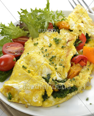 Omelet With Lettuce And Vegetables Stock Photo